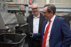 "Premier Mark McGowan inspects graphene ""cake"" with First Graphene Managing Director Craig McGuckin."